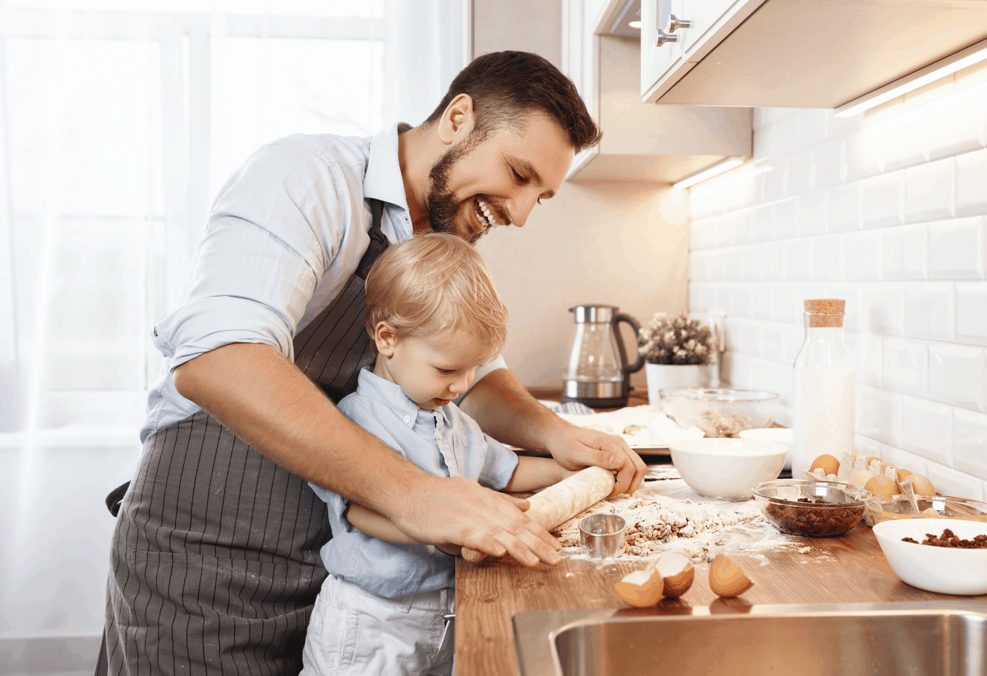 Man and son in kitchen